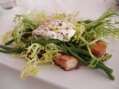 Octopus salad with a poached egg
